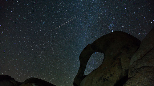 Geminid Meteor above Mobius Arch by evosia