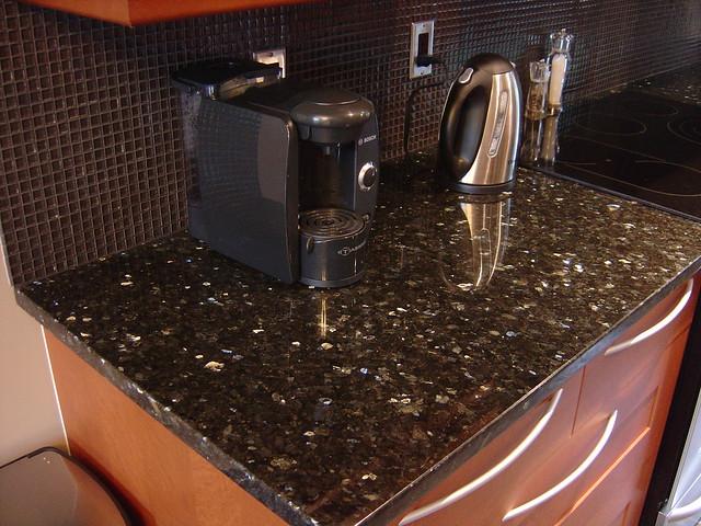 granite countertops with glass tile backsplash flickr photo