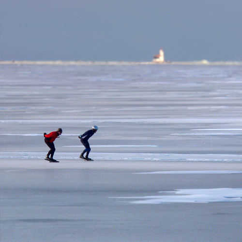 Speed skating next to the lighthouse of Marken