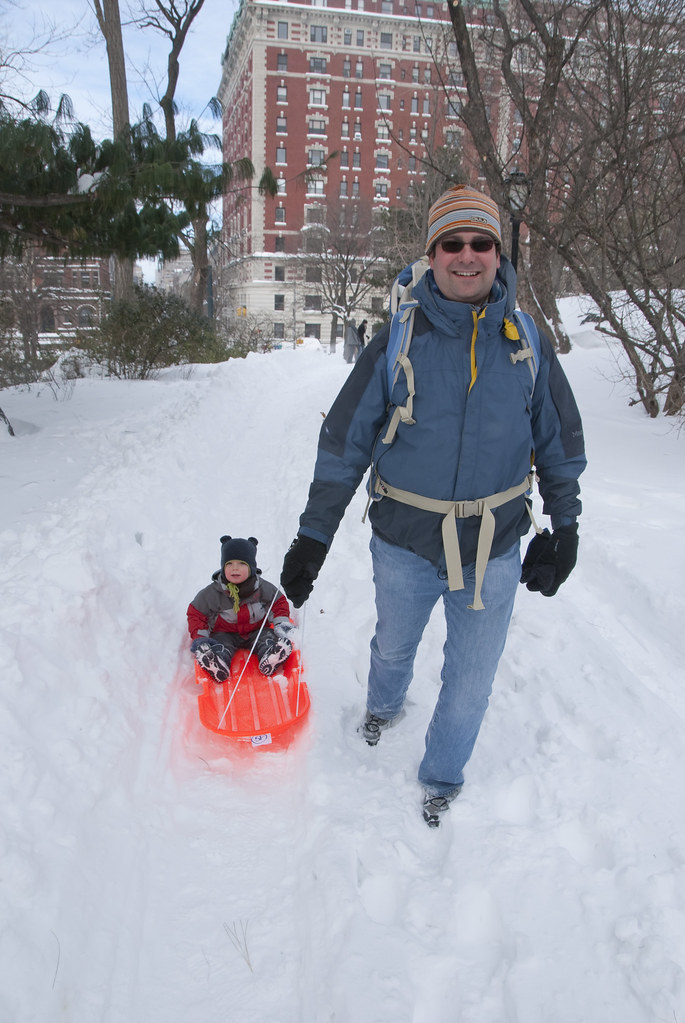 Daddy pulls Tyler to the sledding hill