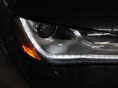 grille(0.0), automobile(1.0), automotive exterior(1.0), wheel(1.0), vehicle(1.0), automotive lighting(1.0), automotive design(1.0), light(1.0), bumper(1.0), headlamp(1.0), land vehicle(1.0),