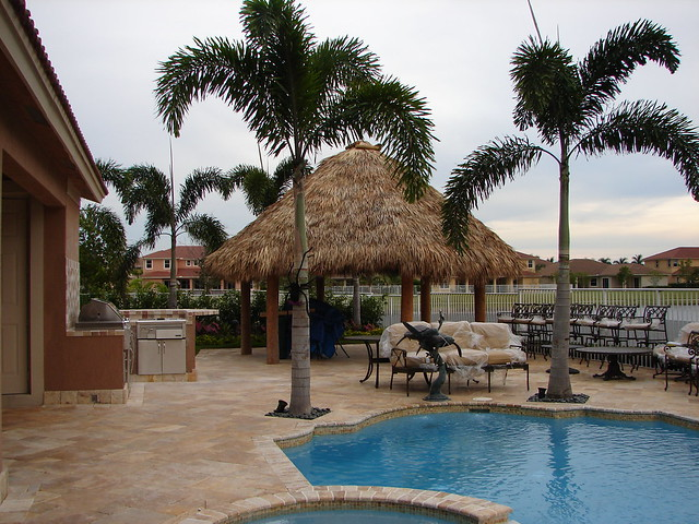 Pool and landscape design with tiki hut and palms for Pool hut designs