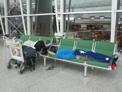 Sleeping at Hong Kong HKG airport.