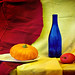 contrast still life with a blue bottle, apple and pumkin