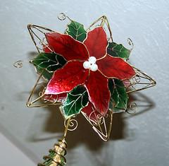 flower arranging(0.0), plant(0.0), jewellery(0.0), flower bouquet(0.0), floristry(0.0), brooch(0.0), earrings(0.0), art(1.0), flower(1.0), leaf(1.0), floral design(1.0), christmas decoration(1.0), petal(1.0),