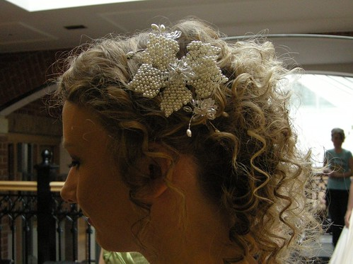 This messy style works wonderfully as a bridal hairstyle