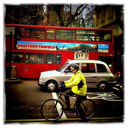 Cyclist, Taxi, Bus