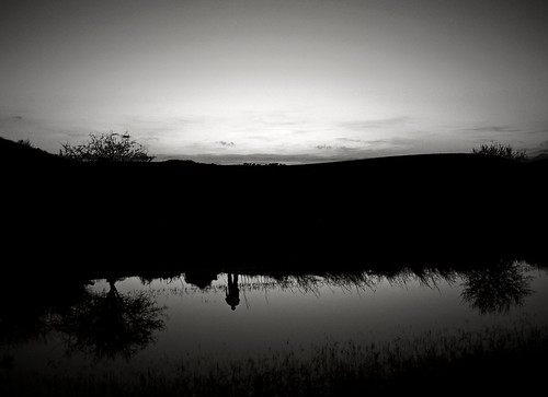trees sunset sky blackandwhite bw plants white man reflection water silhouette reflections lens four lumix person pond hill cyprus panasonic reflected saltlake balck micro pancake 20mm dmc thirds larnaca f17 m43 gf1 κύπροσ georgestavrinos λάρνακα αλυκή m43rds ssjgeorge γιώργοσσταυρινόσ