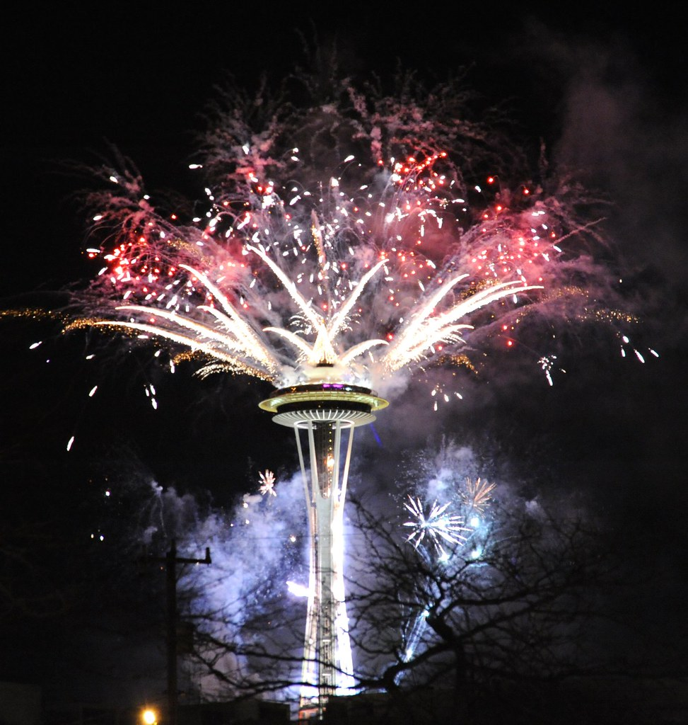 Welcome 2011, Happy New Year, Seattle Space Needle, red and white blue haze fireworks, Washington, USA