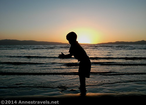 One of the children plays in the sand at the Great Salt Lake, Great Salt Lake State Park, Utah