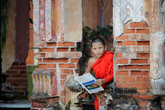 Neophyte reading a book in Temple .