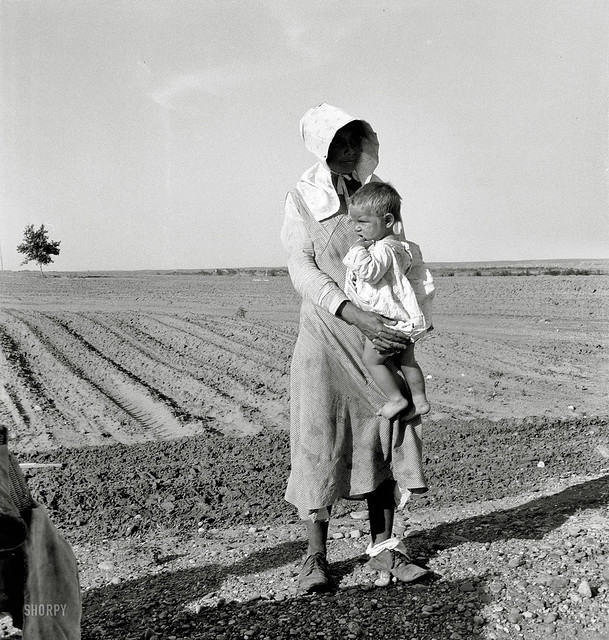 Mother and child of Arkansas flood refugee family near Memphis, Texas. These people, with all their earthly belongings, are bound for the lower Rio Grande Valley, where they hope to pick cotton, by Dorothea Lange 1937