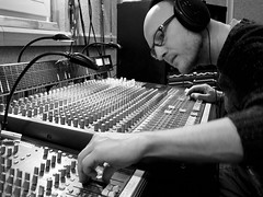monochrome photography, audio engineer, recording, monochrome, black-and-white, person, electronic instrument,