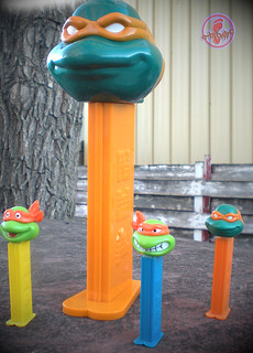 "Brand New LLC:: ""Teenage Mutant Ninja Turtles"" - GIANT PEZ Candy Roll Dispenser, 'MICHELANGELO'  { 2006 reissue } xi // ..with standard 'Michelangelo' '05 PEZ dispenser, 'Michelangelo' '94 Angry & Smiling PEZ Dispensers (( 2010 ))"
