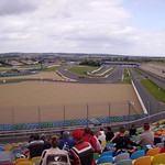 Racing motorcycle on fire in a curve, circuit de Nevers Magny-Cours