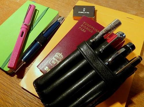 #travelgear six pens, a pocket sized notebook & a pad