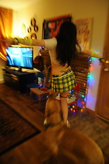 Dani cuts loose after work, dancing with Rosie, antlers, mini skirt, TV, lights, book, living room, Wedgwood, Seattle, Washington, USA
