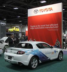 automobile(1.0), automotive exterior(1.0), exhibition(1.0), vehicle(1.0), automotive design(1.0), mazda(1.0), auto show(1.0), land vehicle(1.0), mazda rx-8(1.0), supercar(1.0), sports car(1.0),