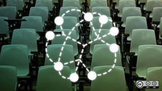 Image of empty chairs in a lecture-room, overlaid with a network