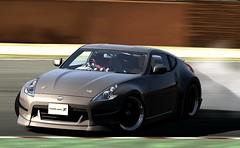 family car(0.0), automobile(1.0), automotive exterior(1.0), wheel(1.0), vehicle(1.0), performance car(1.0), automotive design(1.0), nissan 370z(1.0), nissan(1.0), bumper(1.0), land vehicle(1.0), luxury vehicle(1.0), supercar(1.0), sports car(1.0),