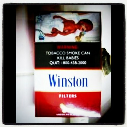 Pack of smokes with dying baby, Singapore 2004