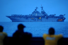 GULF OF THAILAND (March 2, 2011) In this file photo, Sailors watch from a landing craft utility as they pull away from the forward-deployed amphibious assault ship USS Essex (LHD 2) off the coast of Cambodia. (U.S. Navy photo by Mass Communication Specialist 3rd Class Adam M. Bennett)