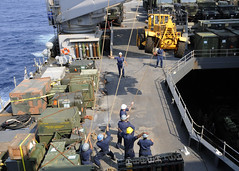 PACIFIC OCEAN (March 14, 2011) Sailors move a fork lift truck aboard the dock landing ship USS Germantown (LSD 42). Germantown is assigned to the forward-deployed Essex Amphibious Ready Group and is preparing to provide disaster relief and humanitarian assistance to Japan as directed in support of Operation Tomodachi. (U.S. Navy photo by Mass Communication Specialist 1st Class Geronimo C. Aquino)