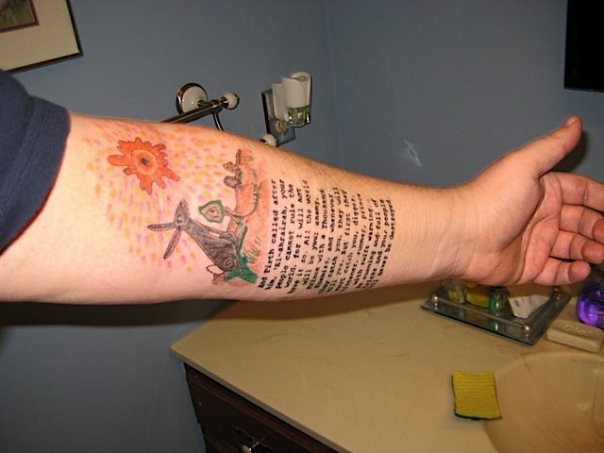 Left arm tattoos Watership Down art above part of the text of the creation