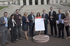 "15 September  2016 - Copyright © Kevin Cooper Photoline NUJ: MLAs at campaign ""More Dough Needed"" to the steps of Parliament Buildings on Thursday 15 September 2016. Mental health rights campaigners from different parts of the north including Belfast, Derry, Draperstown and Cookstown took their campaign to the steps of Parliament Buildings on Thursday 15 September 2016, along with MLAs and mental health charities, to call on the Minister of Health Michelle O'Neill MLA to increase funding for mental health services, as part of their #MoreDoughNeeded campaign. The Mental Health Rights Campaign group gave an Open Letter to the Health Minister calling for funding of mental health services in line with need. While mental health accounts for approximately 25% of health cases it currently receives only 8.5% of the health budget. The open letter was also supported by many MLAs including the Chair and Deputy Chair of the Health Committee, Paula Bradley MLA and Gary Middleton MLA as well as the Chair of the All Party Group on Mental Health Mark H Durkan MLA, who all attendance the #MoreDoughNeeded event. Campaigners held Unfair Share Cake 3 foot cake, individual cup cakes and an A1 size copy of the open letter. Mental Health Rights Campaigners told the Health Minister 'more dough needed'."