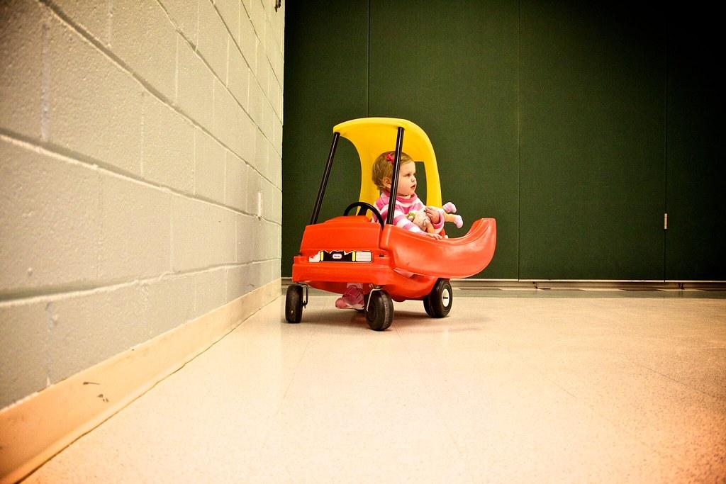 Girl in play car