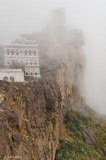 cliffside village amidst fog of Haraz Mountains of Yemen