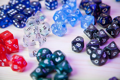 art(0.0), jewelry making(0.0), bead(0.0), indoor games and sports(1.0), purple(1.0), sports(1.0), tabletop game(1.0), font(1.0), dice(1.0), blue(1.0), board game(1.0),