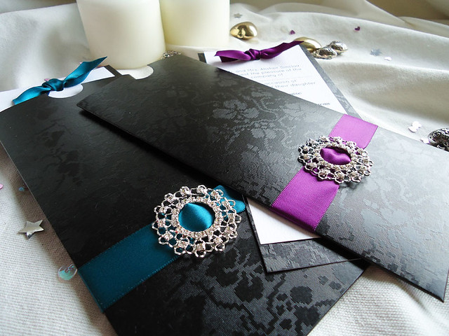 Luxury handmade wedding invitation featuring black broderie card and large