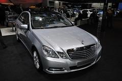 mercedes-benz w221(0.0), automobile(1.0), automotive exterior(1.0), executive car(1.0), mercedes-benz w212(1.0), wheel(1.0), vehicle(1.0), automotive design(1.0), mercedes-benz(1.0), auto show(1.0), bumper(1.0), mercedes-benz e-class(1.0), sedan(1.0), land vehicle(1.0), luxury vehicle(1.0),