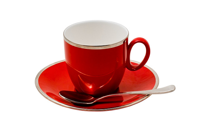 An Empty Red Teacup and Saucer Isolated on White with clipping path
