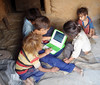 Children in Nepal explore an XO together