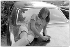 Teenaged girl lying on trunk of car, Kentucky 1971, by William Gedney