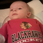 Mar. 9th - Rocking the Blackhawks gear for this first time. Welcome to size 3-6 months.