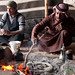 Covering the Bedouin Bread (Abud) with Ashes to Bake - Wadi Rum, Jordan