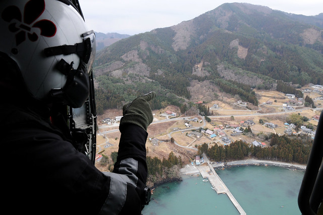 Sailor looks out on post-tsunami Japan during relief efforts.
