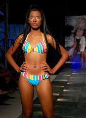 fitness and figure competition(0.0), bodybuilding(0.0), model(1.0), clothing(1.0), abdomen(1.0), muscle(1.0), runway(1.0), leg(1.0), fashion(1.0), fashion show(1.0), thigh(1.0), swimwear(1.0), bikini(1.0),