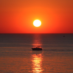 Water, sun and boat: A sonnet in orange, blue, and white