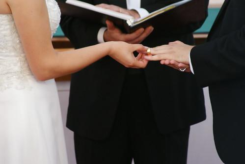 wedding ceremony me put ring on russ closeup