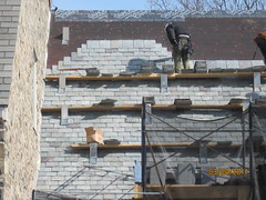 outdoor structure(0.0), reinforced concrete(0.0), roof(0.0), foundation(0.0), wall(1.0), wood(1.0), bricklayer(1.0), construction(1.0), brick(1.0), brickwork(1.0),