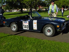 race car, automobile, vehicle, performance car, classic car, land vehicle, triumph tr6, convertible, sports car,