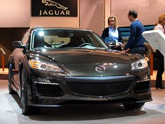 automobile(1.0), automotive exterior(1.0), exhibition(1.0), wheel(1.0), vehicle(1.0), performance car(1.0), automotive design(1.0), mazda(1.0), auto show(1.0), bumper(1.0), land vehicle(1.0), luxury vehicle(1.0), mazda rx-8(1.0), supercar(1.0), sports car(1.0),