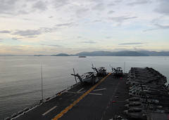 SEPANGAR, Malaysia (March 12, 2001) The forward-deployed amphibious assault ship USS Essex (LHD 2) gets underway from Sepangar, Malaysia to support earthquake and tsunami relief operations in Japan as directed. (U.S. Navy Photo by Mass Communication Specialist 2nd Class Casey H. Kyhl)