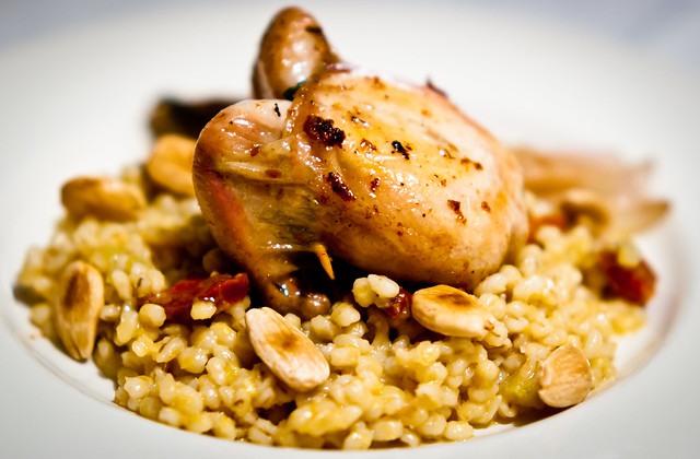 Quail with barley, chorizo and almonds