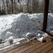Snow banks several feet above the front porch