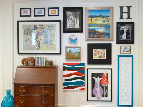 The Easy Way To Hang Artwork On Paneling Without Nails